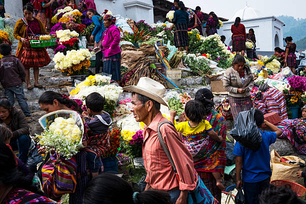 People in a street market in Chichicastenango, in Guatemala stock photo