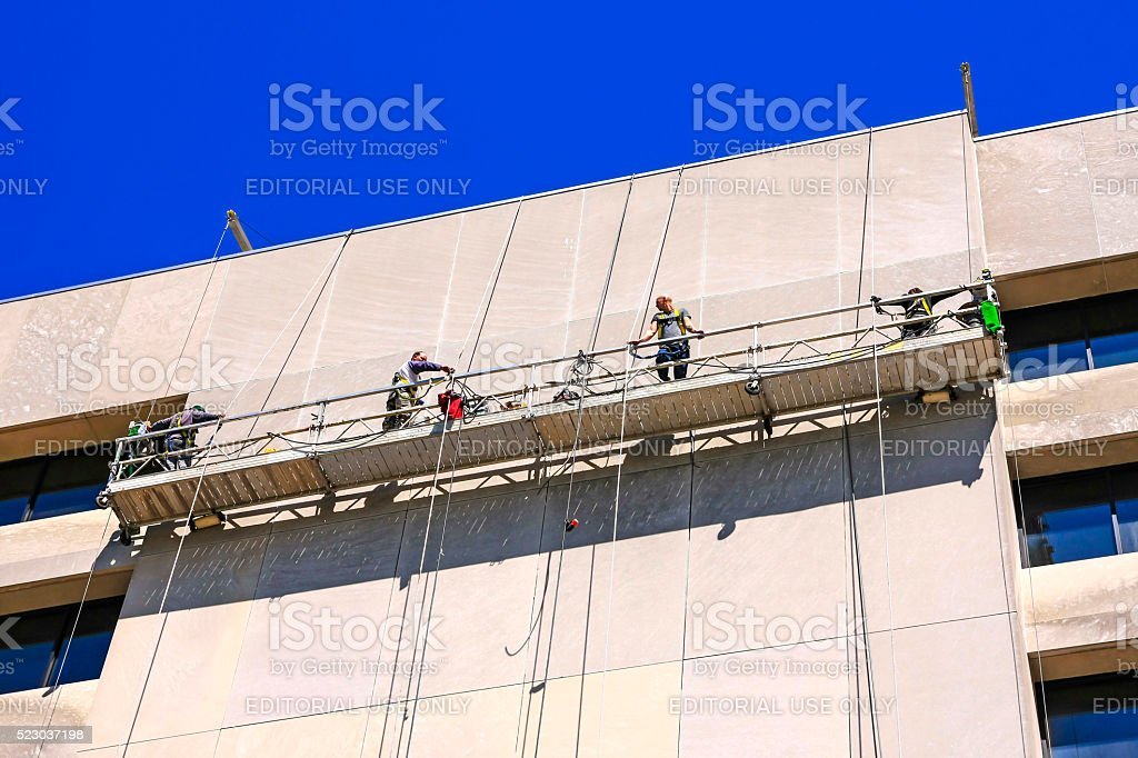 People In A Suspended Scaffold Or Swing Stage In Nashville