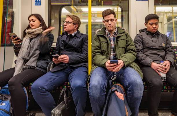 People in a underground train in London stock photo