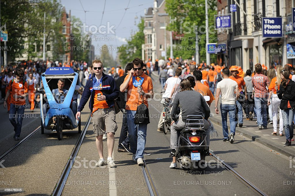 People in Amsterdam on Queen's day royalty-free stock photo
