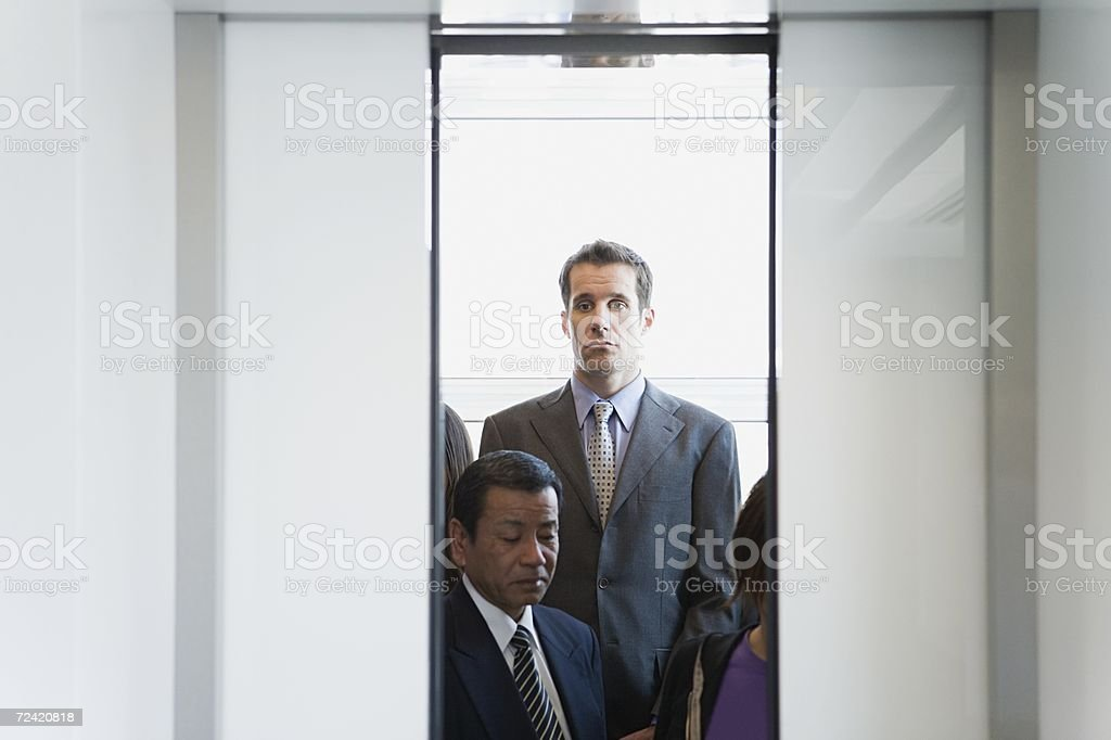 people in elevator. people in an elevator stock photo