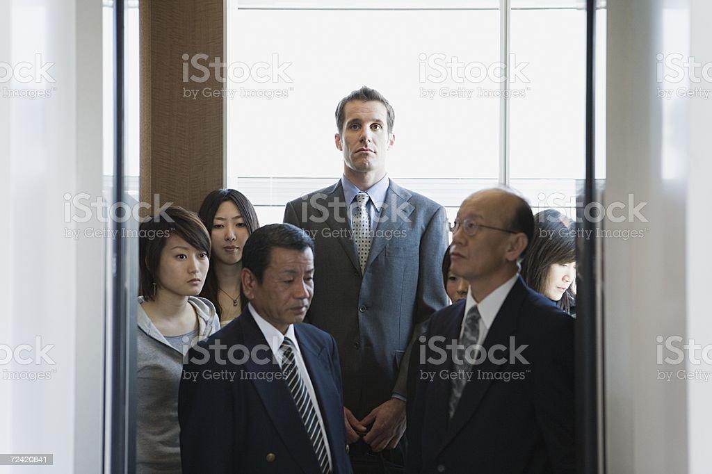 People in an elevator stok fotoğrafı