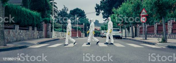 People in bacteriological protection suits walking down an empty picture id1213501714?b=1&k=6&m=1213501714&s=612x612&h=lzpykodju swb jcc4ggsoo0e3kzwxfrrdwks50dq u=