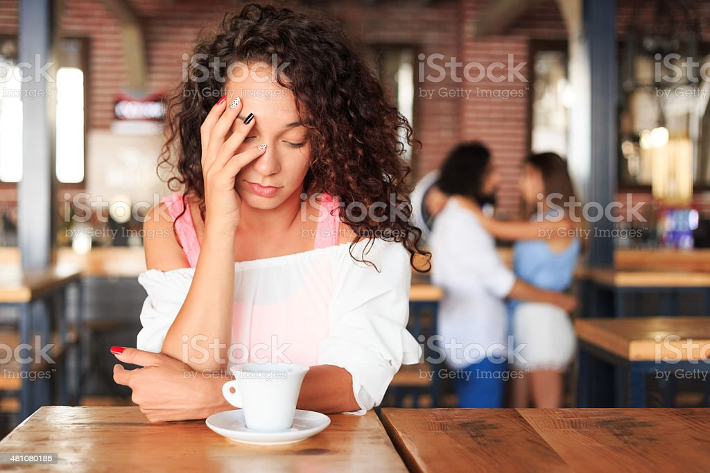 People in bar, woman being abandoned and sad stock photo