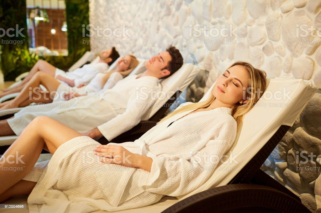 People in bathrobes are resting in the spa salon stock photo