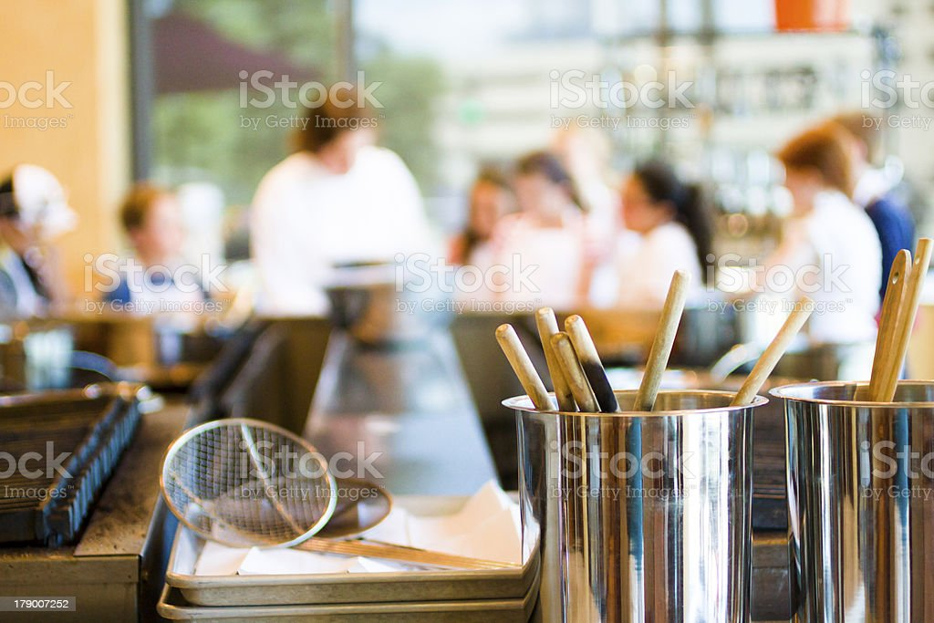 People in cooking class with close-up on utensils stock photo