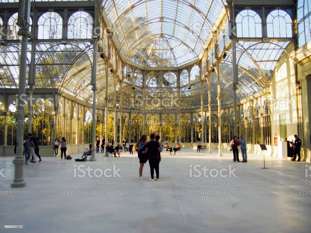 People in Crystal Palace in Retiro park