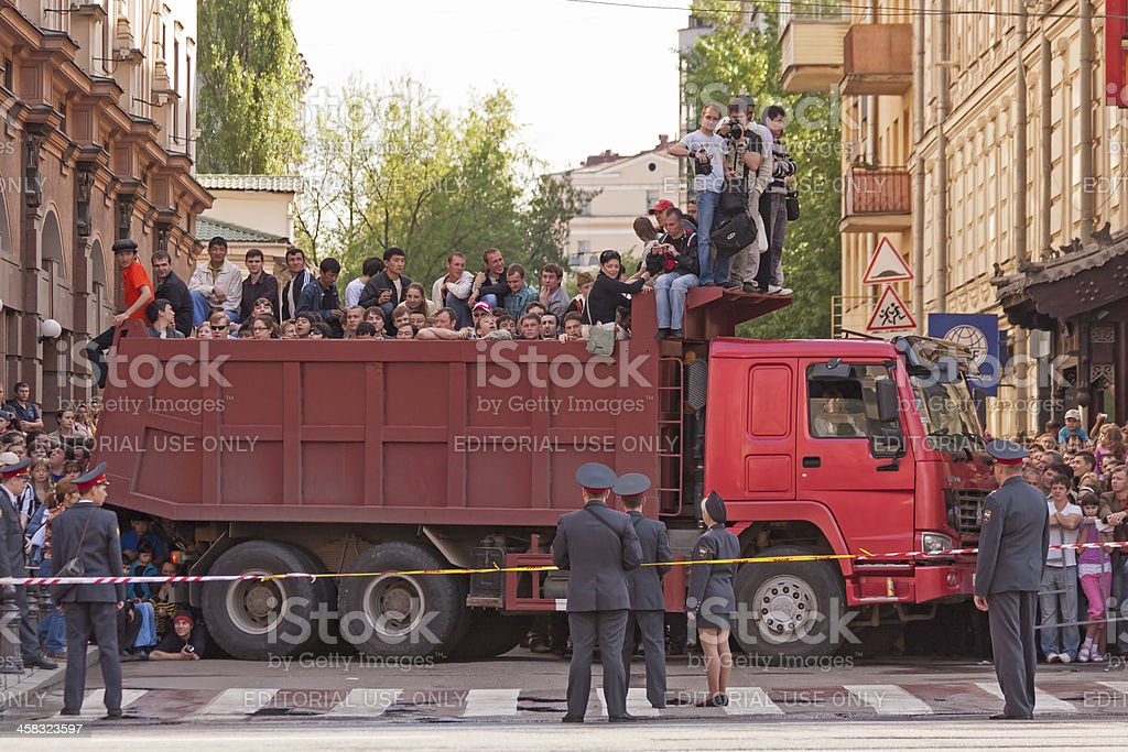 People in dumper body wait for parade beginning on street stock photo