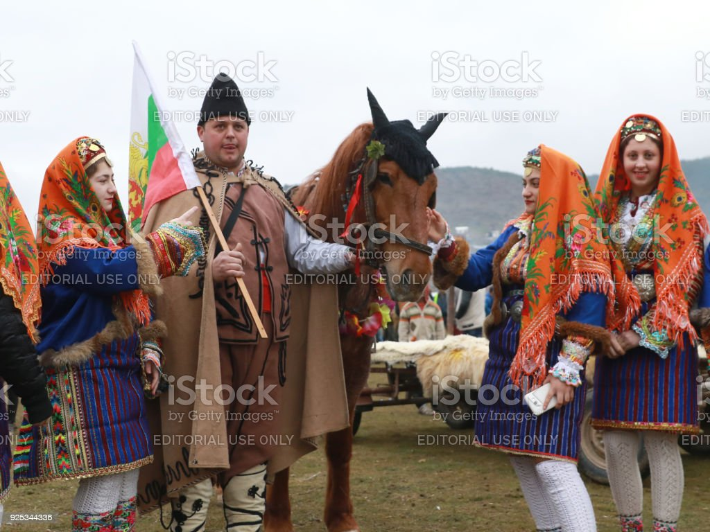 People in folk costumes dance at the Todorov Day holiday near the town of Velingrad