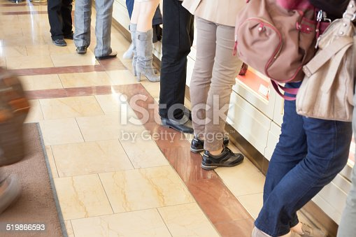 istock people in front of airport counter 519866593