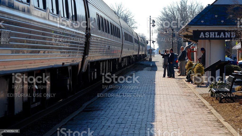 People in front of Amtrak train stock photo