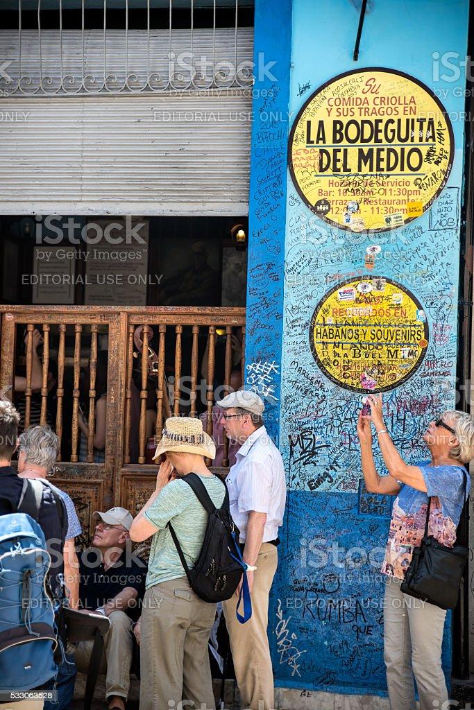 People in front of Bodeguita del Medio, Havana Cuba stock photo