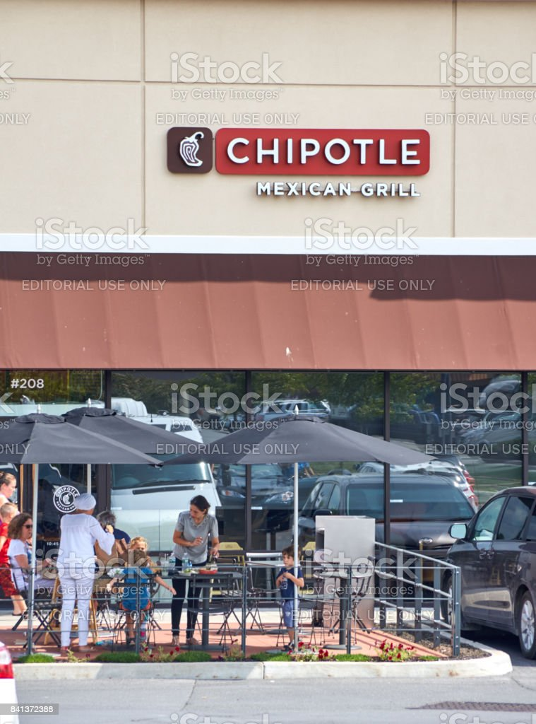 People in front of Chipotle restaurant. stock photo