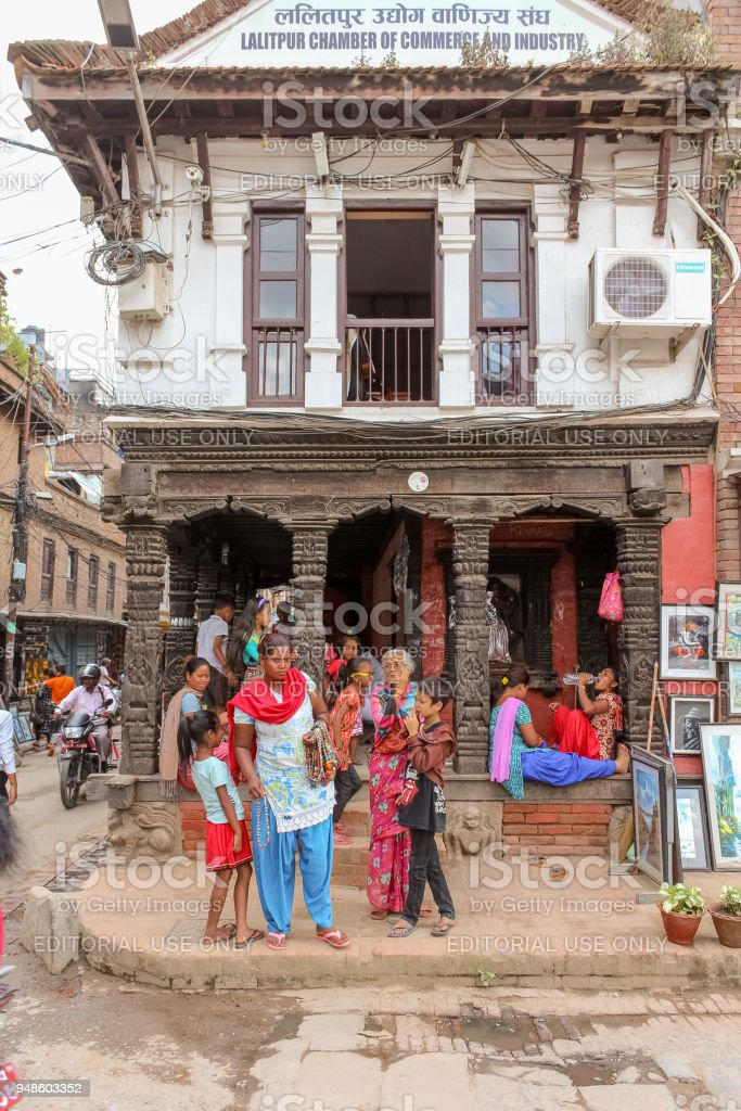 People in front of the building of Lalitpur Chamber of Commerce and Industry in Lalitpur stock photo