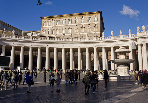 People in front of the colonnade of Piazza San Pietro stock photo