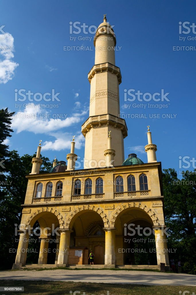 People in front of the Lednice Minaret romantic lookout tower in Lednice Valtice area in Lednice, Czech Republic stock photo