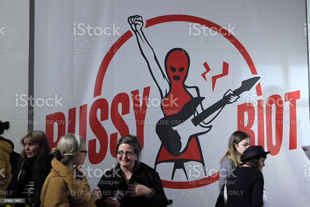 People in front of the Pussy Riot huge poster stock photo
