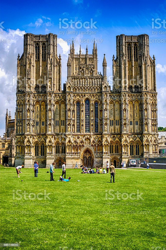 People in front of the West Front of Wells Cathedral stock photo