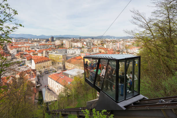 People in funicular on their way to the Ljubljana castle in Ljubljana, Slovenia Ljubljana / Slovenia - April 14 2018:  People in funicular on their way to the Ljubljana castle in Ljubljana, Slovenia ljubljana castle stock pictures, royalty-free photos & images