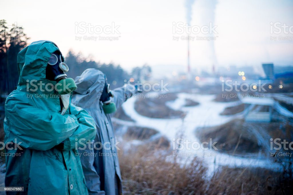 People in gas masks stock photo