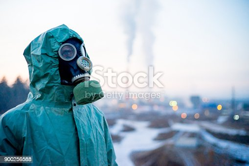 istock People in gas masks 900256588