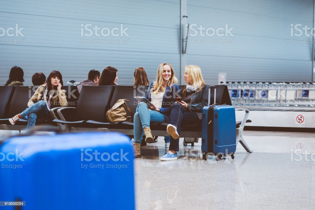 People in international airport waiting for flight stock photo
