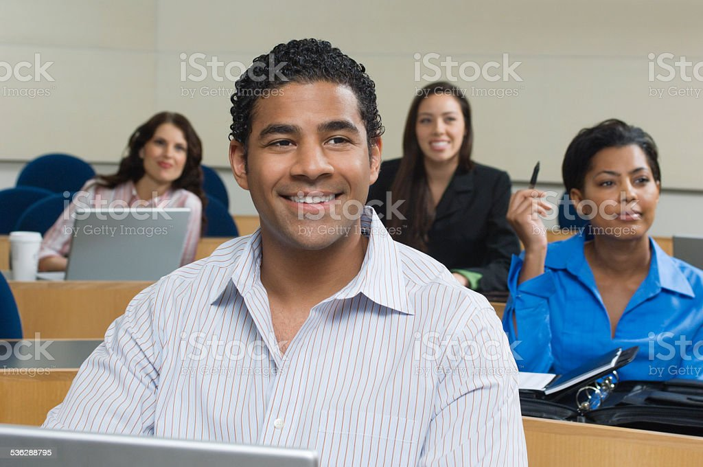 People in lecture theatre stock photo