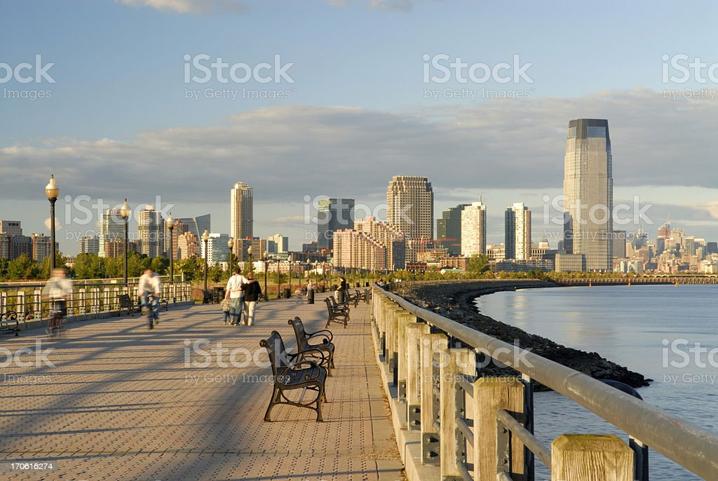 People in Liberty Park of New Jersey at Sunset stock photo