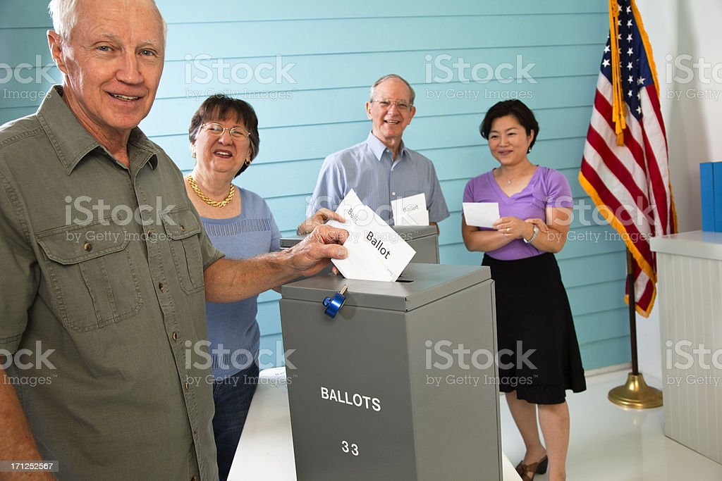 People in line casting their ballot. Voting. Voters. USA. Group. royalty-free stock photo