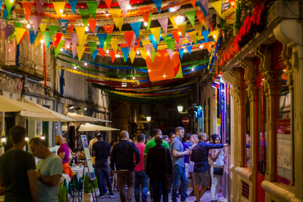 people in lisbon street during popular saints festival - people lisbon imagens e fotografias de stock