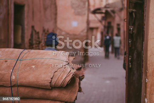 Marrakech,Morocco, 25th March 2018: People in traditional moroccan clothing walking in the Medina in Marrakech,Morocco.