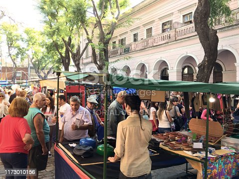 Buenos Aires, Argentina - April 7, 2019: People looking at artisanal works in the Mataderos street fair that is held every sunday in the neighborhood of the same name. The place is famous for its traditions and its meat