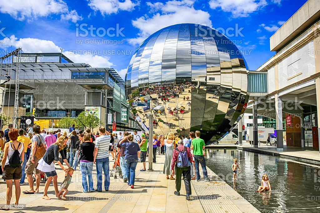 People in Millenium Square by the Planetarium orb, Bristol UK stock photo