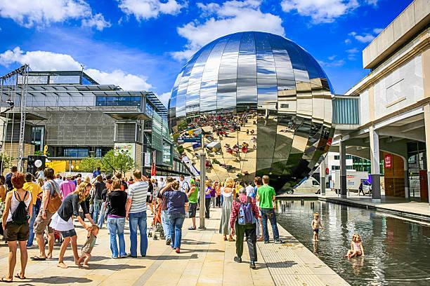 People in Millenium Square by the Planetarium orb, Bristol UK stock photo