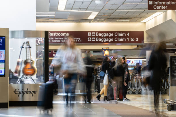 People in motion in the baggage claim area at Nashville International Airport (BNA)