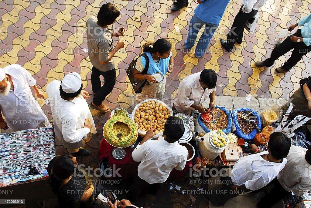 People in Mumbai buying snacks on street market stock photo
