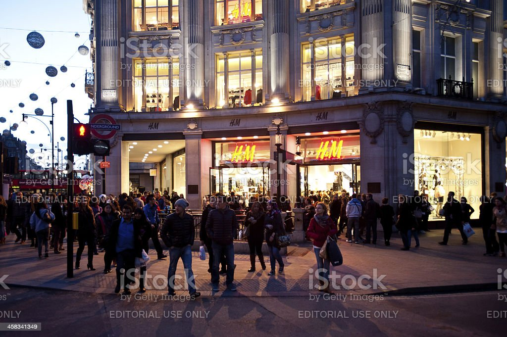People in Oxford Circus, London at sunset stock photo