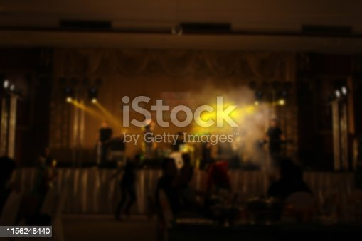 860440036istockphoto People in parties or celebrations blur at night. 1156248440