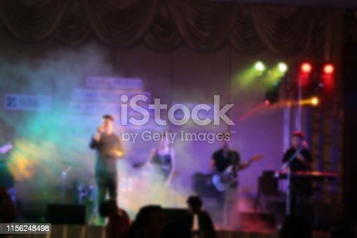 860440036istockphoto People in parties or celebrations blur at night. 1156248498