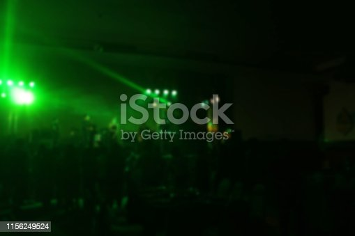 860440036istockphoto People in parties or celebrations blur at night. 1156249524