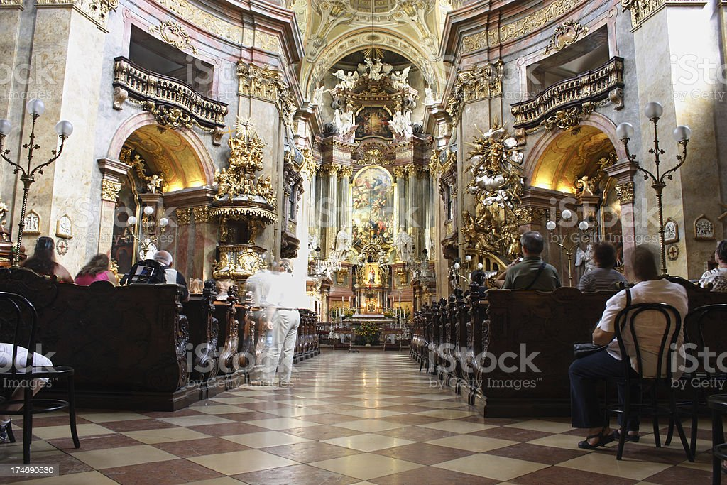 People in prayer at a Catholic church royalty-free stock photo