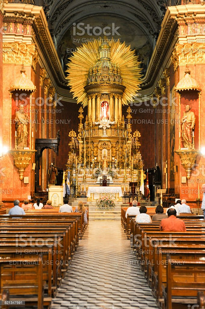 People in prayer at the cathedral of Salta stock photo