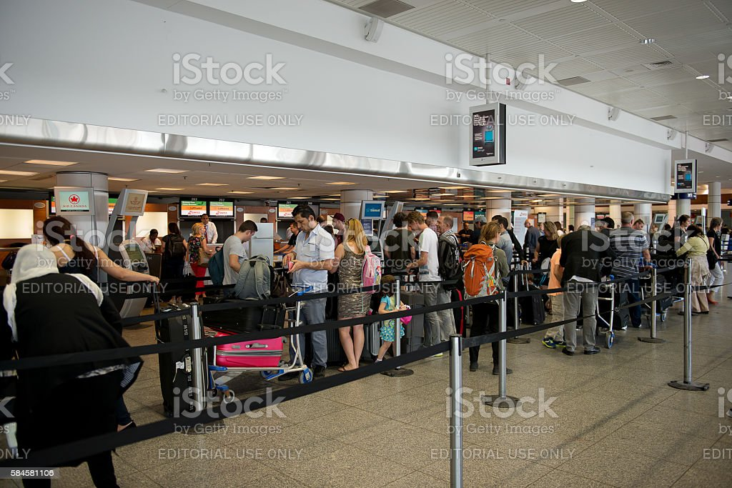 People in queue waiting to registration. Montreal airport interior stock photo