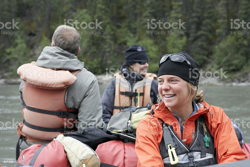 people in raft on river royalty free stockfoto