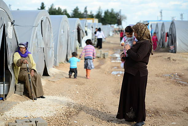 People in refugee camp picture id470436874?b=1&k=6&m=470436874&s=612x612&w=0&h= uow1rw n3knuiuqw3akw0ygiardig6orx3iivyjt0m=