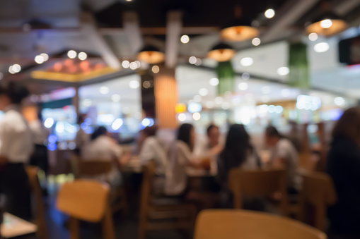 People in restaurant cafe interior with bokeh light blurred customer abstract background
