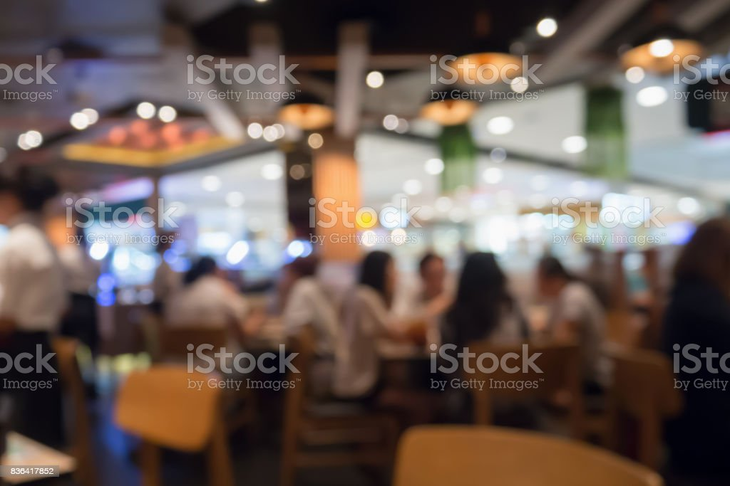 People in restaurant cafe interior with bokeh light blurred customer abstract background stock photo