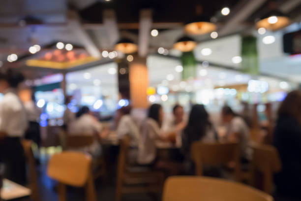 people in restaurant cafe interior with bokeh light blurred customer abstract background - fast food restaurant stock pictures, royalty-free photos & images