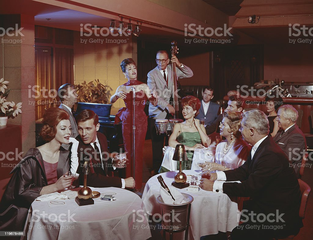 People in restaurant listening musical performance stock photo