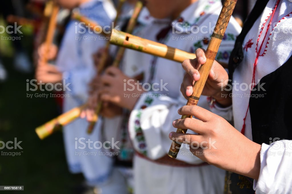 People in romanian traditional costumes stock photo